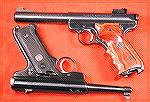 A couple of MK-II''s, a bull barrel with target grips, and the 50th Anniversary model, stock.Two Ruger MK-II PistolsJohn Will