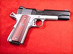Here's a two-tone springfield 1911.  I sent this one off to SM&A for their Tactical Carry Package, very nice gun.