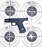 Factory stock Glock 22 with Glock night sights, fired at Black Wing Shooting Center on 11-26-06. Blazer 180gr .40SW ammo. Using the factory night sights, one can see they are not precise enough for ta
