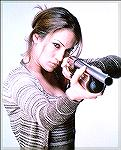 Actress Jennifer Lopez shows us how to hold a shotgun in this shot from some movie or another...