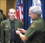 Inactive forum member Chuck Hubbert's oldest son Andy, shown graduating from the US Border Patrol Academy.  Andy is stationed in Texas.  I've known Andy since he was a skinny little pre-teen with glas