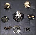 In answer to a forum question about two-piece brass, this is a picture of some of my old brass (about 50 years old).  The top row are as-issued lapel insignias, stamped from thin sheet brass.  The mid
