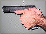 This is another variation of the modern Thumbs Forward grip where the offhand wrist is exaggeratedly cocked, putting the hand lower on the gun and the thumb further forward on the pistol.