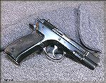 CZ 75 9mm pistol, built in 1987, no import mark, original 15 round magazines (current models use 16 round magazines).