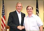 "Engraver Brian Powley of Ohio presents President Bush with ""The President George W. Bush Commemorative Pistol.""  This pistol was worked on by various folks, see adjacent images of the pistol."