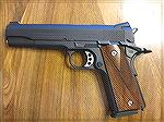 My old Colt 1911. It was a Navy Model from 1912/13, but it was refurbed with a new finish and slide prior to or during WWII.