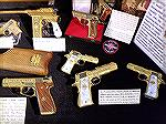 Gold Damascened Spanish handguns seen in a collection displayed in the NRA Collectors area at the 2019 NRA Annual Meetings & Trade Show. Visible are an Astra M902, an Astra A-60, a Llama Omni, and a s