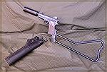 "US Navy SEAL MK 22 ""Hushpuppy"" pistol with attachable stock from the Vietnam War era.  This pistol is in the SEAL Museum according to the info found with the image."