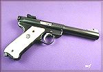Ruger Mk.II .22 pistol in blue with the five and half inch bull barrel.  Stocks are aftemarket ivory polymer with Ruger emblem.